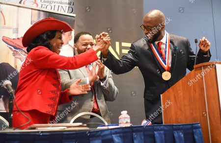 Frederica Wilson, Rickey Smiley Rep. Frederica Wilson, D-Fla., congratulates nationally syndicated radio personality Rickey Smiley during the TV One's Screening Bad Dad Rehab at the Walter E. Washington Convention Center, in Washington, D.C