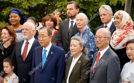 Peace Bell U.N. Secretary-General Ban Ki-moon, center-front, stands beside his wife Yoo Soon-taek, surrounded by U.N. officials, including U.N. Messengers of Peace Leonardo DiCaprio, center-rear, Jane Goodall, third from right-rear, Michael Douglas, second from right-rear, after the ringing of the Peace Bell at a ceremony to mark the 35th Anniversary of the International Day of Peace, at U.N. headquarters