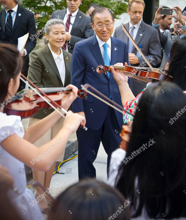 Peace Bell Yoo Soon-taek and her husband U.N. Secretary-General Ban Ki-moon, center, listens as a youth orchestra plays after the ringing of the Peace Bell, at a ceremony to mark the 35th Anniversary of the International Day of Peace, at U.N. headquarters