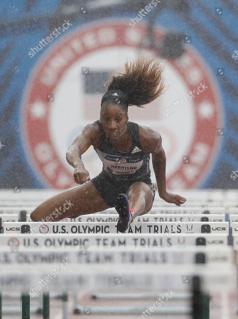 Queen Harrison wins her heat during the semifinals in the women's 100-meter hurdles at the U.S. Olympic Track and Field Trials, Friday, July 8, 2016, in Eugene Ore.