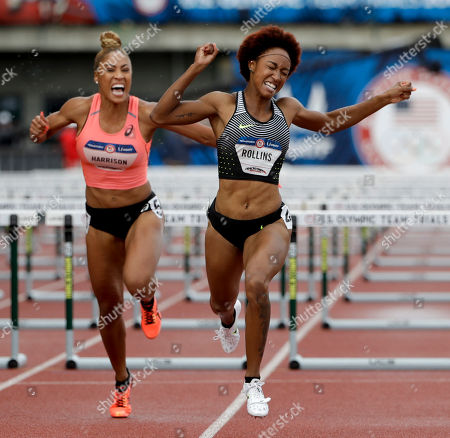 Brianna Rollins, right, celebrates her win past Queen Harrison in the women's 400-meter final at the U.S. Olympic Track and Field Trials, Friday, July 8, 2016, in Eugene Ore