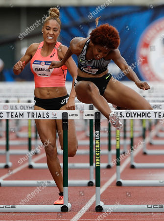 Brianna Rollins, right, clears the last hurdle past Queen Harrison in the final of the women's 100-meter hurdles at the U.S. Olympic Track and Field Trials, Friday, July 8, 2016, in Eugene Ore.