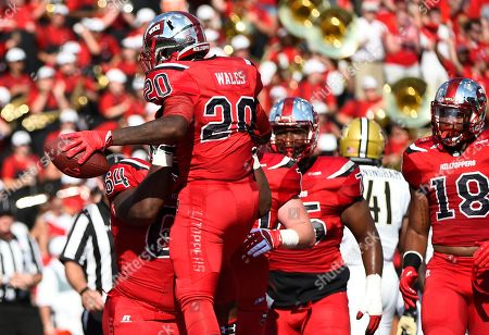 Stock Picture of Western Kentucky University running back Anthony Wales (20) celebrates with teammate offensive lineman Dennis Edwards (64) in an NCAA college football game against Vanderbilt, in Bowling Green, Ky