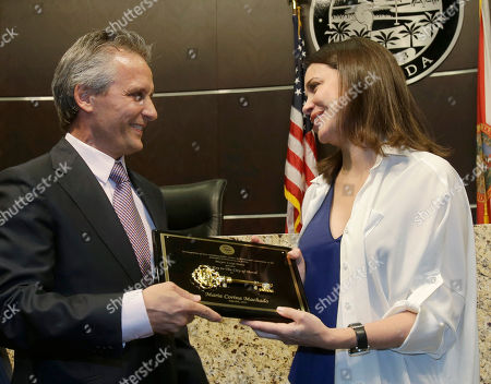 Stock Image of Maria Corina Machado, Luigi Boria Doral, Fla. Mayor Luigi Boria, left, and Venezuelan opposition leader Maria Corina Machado pose for a photo after Boria presented Machado a key to the city during a ceremony, in Doral. The Miami suburb of Doral, which has the largest population of Venezuelans outside the South American country, hosted Machado, who ran in Venezuela's opposition primaries for the presidential election last year. She lost but became the national coordinator for candidate Henrique Capriles