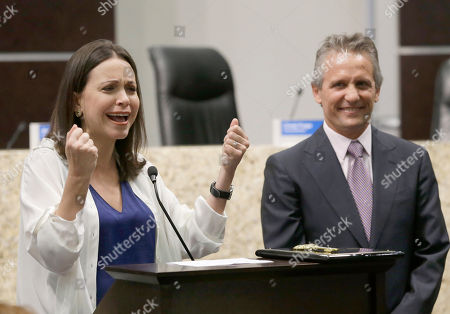 Stock Photo of Maria Corina Machado, Luigi Boria Venezuelan opposition leader Maria Corina Machado, left, gestures as she speaks to the crowd after having been given the key to the city by Doral, Fla. Mayor Luigi Boria, right, during a ceremony, in Doral. The Miami suburb of Doral, which has the largest population of Venezuelans outside the South American country, hosted Machado, who ran in Venezuela's opposition primaries for the presidential election last year. She lost but became the national coordinator for candidate Henrique Capriles