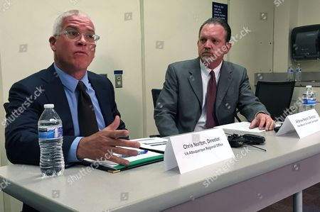 Veteran's Administration's Albuquerque Regional Office director Chris Norton, left, and New Mexico VA Health Care System director Andrew Welch, right, talk to reporters Friday, July 8, 2016, about changes being make to veterans' health care in Albuquerque, N.M.. Veterans Affairs' health care system officials in New Mexico say they are adopting various charges to improve access amid a critical Office of Inspector General report.