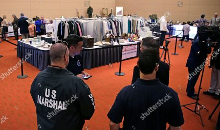 "U.S. Marshals keep watch on a room full of personal items belonging to James ""Whitey"" Bulger and Catherine Greig, which will be auctioned off this weekend at the Boston Convention Center, Friday, June 24, 2016, in Boston. The proceeds will be divided among the families of Bulger's victims."