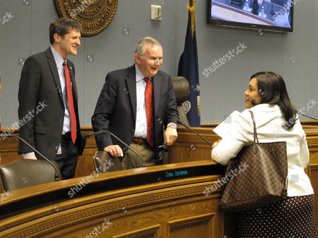 Patrick Goldsmith, director of the House Fiscal Division, left, and LSU economist Jim Richardson speak with Revenue Secretary Kimberly Robinson ahead of a meeting of the state income forecasting panel, on Thursday, June 30, 2016, in Baton Rouge, La. The Revenue Estimating Conference discussed the latest state financial forecast.
