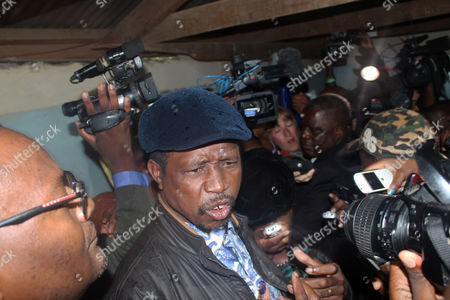 Edgar Lungu one of the Presidential candidates, talks to the press after casting his vote on election day in Lusaka, Tuesday, Jan, 20, 2015. Zambians lined up at polling stations on Tuesday to vote for a successor to President Michael Sata, who died in October after a long illness