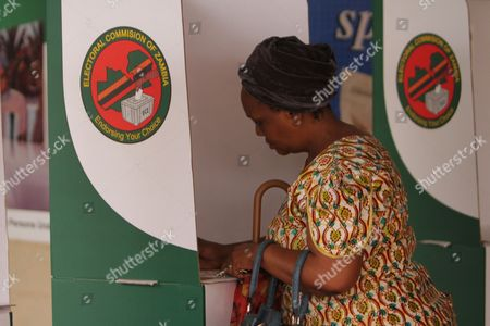 A woman prepares to cast her ballot during presidential election day in Lusaka, . Zambians are voting to choose a new leader following the death of Michael Sata, 77, who died Oct. 2014, in a London hospital following a long illness, after serving as President of the Southern African country since 2011