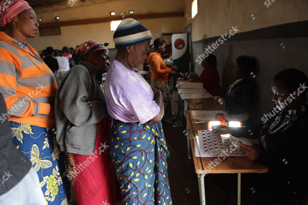 Women checks the names of voters on the election roll, at a voting station on presidential election day in Lusaka, . Zambians are voting to choose a new leader following the death of Michael Sata, 77, who died Oct. 2014, in a London hospital following a long illness, after serving as President of the Southern African country since 2011