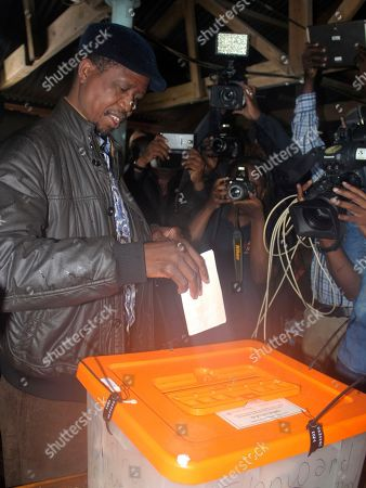 Edgar Lungu, a candidate in the presidential elections, casts his vote on election day in Lusaka, Tuesday, Jan, 20, 2015. Zambians lined up at polling stations on Tuesday to vote for a successor to President Michael Sata, who died in October after a long illness