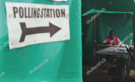 An election agent waits for people to cast their vote at a polling station on election day in Lusaka, Tuesday, Jan, 20, 2015. Zambians are voting to choose a new leader following the death of president Michael Sata, in October 2014