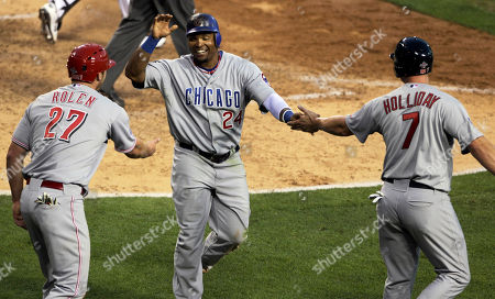 Stock Image of Scott Rolen, Marlon Byrd, Matt Holliday National League's Scott Rolen, left, of the Cincinnati Reds, and Matt Holliday, right, of the St. Louis Cardinals, react with Marlon Byrd, of the Chicago Cubs, after all scored on a double by Brian McCann, of the Atlanta Braves, during the seventh inning of the All-Star baseball game, in Anaheim, Calif. The National League won 3-1