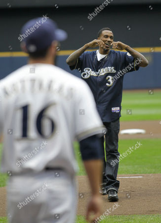 Milwaukee Bucks Brandon Jennings throws out the ceremonial first pitch before the first inning of a baseball game Milwaukee Brewers and Houston Astros, in Milwaukee