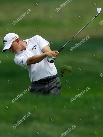 Derek Lamely hits on the 12th hole during the Aronimink Golf Club Pro-Am at the AT&T National golf tournament, in Newtown Square, Pa
