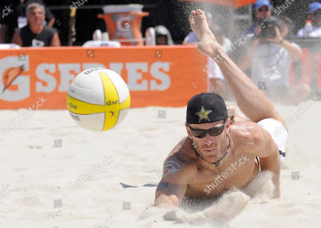 John Hyden John Hyden dives but misses a dig during a match with partner Sean Scott against Phil Dalhausser and Todd Rogers in the men's beach volleyball final at the AVP Long Beach Open, in Long Beach, Calif. Dalhausser and Rogers won the match