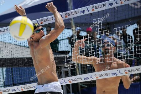 Todd Rogers, Sean Scott Todd Rogers, right, spikes the ball past Sean Scott in the men's beach volleyball final at the AVP Long Beach Open, in Long Beach, Calif. Rogers, with partner Phil Dalhausser, won against Sean Scott and John Hyden