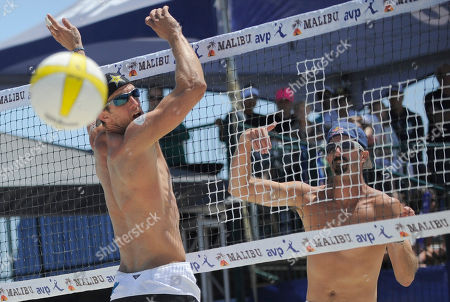 Todd Rogers, Sean Scott Todd Rogers, right, spikes the ball past Sean Scott in the men's volleyball final at the AVP Nivea Tour Long Beach Open, in Long Beach, Calif. Rogers, with partner Phil Dalhausser, won against Sean Scott and Todd Rogers in three games