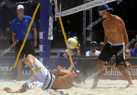 John Hyden, Todd Rogers John Hyden, bottom left, can't save a dig while opponent Todd Rogers, right, watches during the men's beach volleyball final at the AVP Nivea Tour Long Beach Open, in Long Beach, Calif. Reigning Olympic gold medalists Rogers and partner Phil Dalhausser won the match against Hyden and Sean Scott in three games