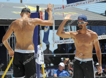 Phil Dalhausser, Todd Rogers Reigning Olympic gold medalists Phil Dalhausser and Todd Rogers, from left, celebrate a point during the pair's winning match against Sean Scott and John Hyden in the men's beach volleyball final at the AVP Nivea Tour Long Beach Open, in Long Beach, Calif