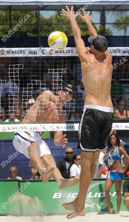 Sean Scott, Phil Dalhausser Sean Scott, left, spikes the ball past Phil Dalhausser in the men's beach volleyball final at the AVP Nivea Tour Long Beach Open, in Long Beach, Calif. Reigning Olympic gold medalists Dalhausser and partner Todd Rogers won the match against Scott and John Hyden in three games