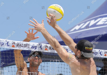 Phil Dalhausser, John Hyden Phil Dalhausser, left, spikes the ball past John Hyden in the men's beach volleyball final at the AVP Nivea Tour Long Beach Open, in Long Beach, Calif. Reigning Olympic gold medalists Dalhausser and partner Todd Rogers won the match against Hyden and Sean Scott in three games