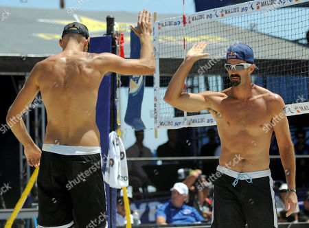Stock Picture of Phil Dalhausser, Todd Rogers Reigning Olympic gold medalists Phil Dalhausser and Todd Rogers, from left, celebrate a point during the pair's winning match against Sean Scott and John Hyden in the men's beach volleyball final at the AVP Nivea Tour Long Beach Open, in Long Beach, Calif