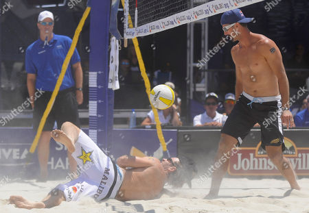 Stock Photo of John Hyden, Todd Rogers John Hyden, bottom left, can't save a dig while opponent Todd Rogers, right, watches during the men's beach volleyball final at the AVP Nivea Tour Long Beach Open, in Long Beach, Calif. Reigning Olympic gold medalists Rogers and partner Phil Dalhausser won the match against Hyden and Sean Scott in three games