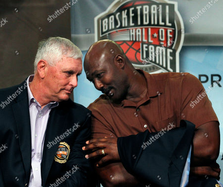 Karl Malone, Robert Hurley Sr Basketball Hall of Fame inductee Karl Malone, right, leans to speak with fellow inductee Robert Hurley, Sr. during the enshrinement news conference at the Hall of Fame Museum in Springfield, Mass