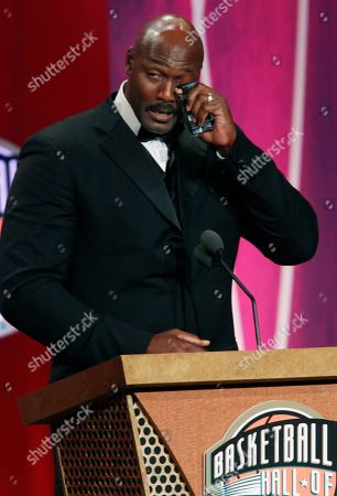 Karl Malone 2010 Basketball Hall of Fame inductee Karl Malone wipes tears as he speaks during his enshrinement ceremony in Springfield, Mass