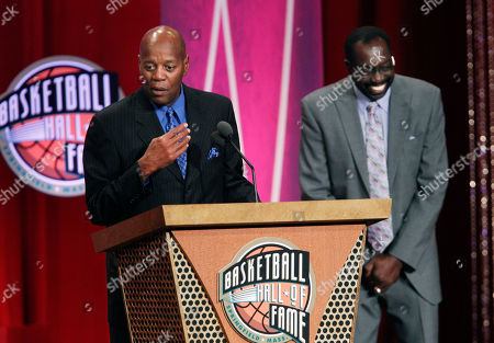 """Earl Monroe, Perry Johnson Former New York Knicks player Earl """"The Pearl"""" Monroe, right, laughs as Perry Johnson, brother of Basketball Hall of Fame inductee Gus Johnson, speaks on behalf of his brother, inducted posthumously, during enshrinement ceremonies in Springfield, Mass"""