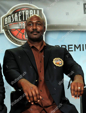 Karl Malone Basketball Hall of Fame inductee Karl Malone reacts as he shows his new jacket with sleeves much too short during the enshrinement news conference at the Hall of Fame Museum in Springfield, Mass