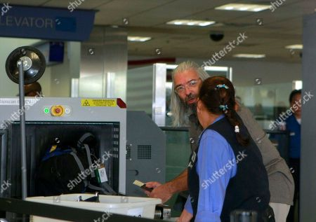 Gary Faulkner Gary Faulkner goes through airport screening, on Wednesday afternoon after he arrived at Los Angeles International Airport, in Los Angeles. Faulkner went on a solo mission to hunt down Osama bin Laden, came back in the United States, 10 days after authorities found him in the woods of northern Pakistan. Faulkner, armed with a pistol and a 40-inch sword, was detained Tuesday in northern Pakistan as he tried to cross the border into Afghanistan on a mission to avenge the 9/11 attacks and kill Osama bin Laden, police said