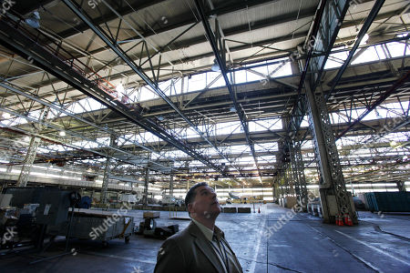 """A Boeing Co. historian Mike Lombardi walks through Boeing's historic and now nearly empty """"Plant 2,"""" in Seattle. After giving birth to some of the world's most significant aircraft, the outdated facility is scheduled to be torn down this fall"""