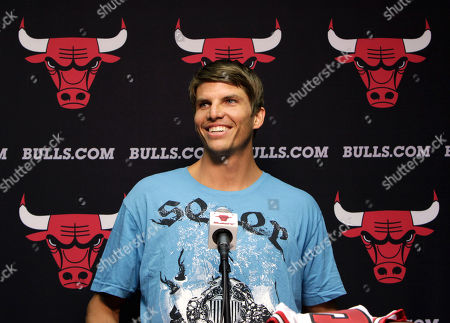 Stock Photo of Kyle Korver Kyle Korver holds makes a plug for his T-shirt company, Seer Clothing, after Chicago Bulls general manager Gar Forman introduced him during a news conference, in Chicago. Korver follows fellow Utah Jazz free agent Carlos Boozer in signing with the Bulls
