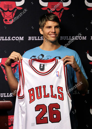 Stock Picture of Kyle Korver Kyle Korver holds his jersey after Chicago Bulls general manager Gar Forman introduced him during a news conference, in Chicago. Korver follows fellow Utah Jazz free agent teammate Carlos Boozer in signing with the Bulls