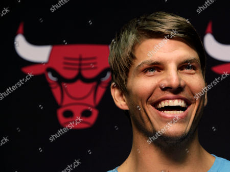 Stock Image of Kyle Korver Kyle Korver smiles after Chicago Bulls general manager Gar Forman introduced him during a news conference, in Chicago. Korver follows fellow Utah Jazz free agent teammate Carlos Boozer in signing with the Bulls