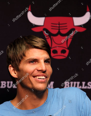 Kyle Korver Kyle Korver smiles after Chicago Bulls general manager Gar Forman introduced him during a news conference, in Chicago. Korver follows fellow Utah Jazz free agent teammate Carlos Boozer in signing with the Bulls