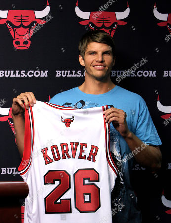 Kyle Korver Kyle Korver holds his jersey after Chicago Bulls general manager Gar Forman introduced him during a news conference, in Chicago. Korver follows fellow Utah Jazz free agent teammate Carlos Boozer in signing with the Bulls