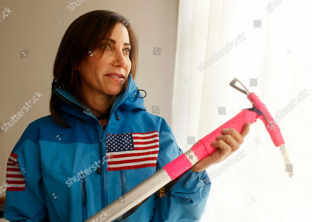 Alison Levine In this, photo, adventurer Alison Levine holds a favorite ice axe inscribed with the name of a late close friend at her home in San Francisco. Levine made history by becoming one of the few Americans to complete the adventure grand slam, climbing the highest peak on every continent and skiing to both the North and South poles
