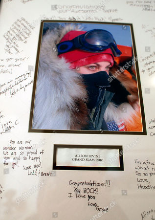 In this, photo, signatures surround a tribute to adventurer Alison Levine at her home in San Francisco. Levine made history by becoming one of the few Americans to complete the adventure grand slam, climbing the highest peak on each continent and skiing to both the North and South poles
