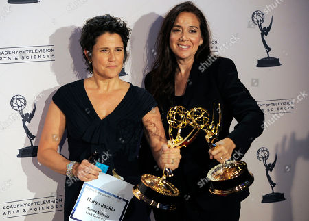 """Wendy Melvoin, Lisa Coleman Wendy Melvoin, left, and Lisa Coleman pose with the award for oustanding original main title theme music for """"Nurse Jackie"""" in the press room at the Creative Arts Emmy Awards on in Los Angeles"""