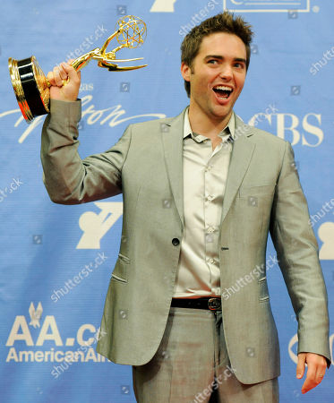 """Drew Tyler Bell Drew Tyler Bell, a cast member in """"The Bold and the Beautiful,"""" poses with his Daytime Emmy for Outstanding Younger Actor in a Drama Series backstage at the Annual Daytime Emmy Awards in Las Vegas"""