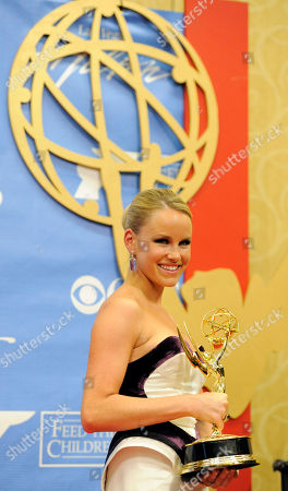 """Julie Berman Julie Berman, a cast member in """"General Hospital,"""" poses with her Daytime Emmy for Outstanding Younger Actress in a Drama Series backstage at the Annual Daytime Emmy Awards in Las Vegas"""