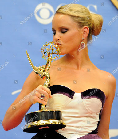 """Julie Berman Julie Berman, a cast member in """"General Hospital,"""" kisses her Daytime Emmy for Outstanding Younger Actress in a Drama Series backstage at the Annual Daytime Emmy Awards in Las Vegas"""