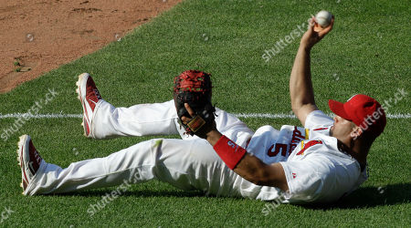 Albert Pujols St. Louis Cardinals first baseman Albert Pujols throws out Los Angeles Dodgers' Garret Anderson at first after diving for a ball hit hard down the line during the eighth inning of a baseball game, in St. Louis