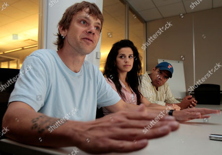"""Jacob Pokluda, Shirley Rumierk, J. Salome Martinez Producer Jacob Pokluda, left, actress Shirley Rumierk, center, and actor J. Salome Martinez Jr., are shown in an interview about their movie """"Ilegales"""", in New York"""