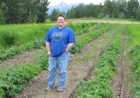 Stock Photo of Jodie Anderson, a community horticulture director for the University of Alaska Fairbanks, poses for a photo, at the Matanuska Experiment Farm in Palmer, Alaska. Alaska has abundant natural resources, but soil isn't among them. To help Alaskans create their own dirt, and grow gardens to supplement hunting, fishing and gathering, a modest federal grant is paying for five demonstration gardens from the Panhandle to the Arctic, using soil mixed from local sources