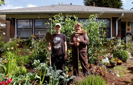 """Donna Smith, Robyn Streeter Gardening Backyard Farms Donna Smith, right, and Robyn Streeter pose for a photo in a residential front yard vegetable and flower garden they created in Portland, Ore., . Your Backyard Farmer began in 2006 when Smith and Streeter were growing weary of driving through the city's outskirts looking for affordable land to farm. The thought struck them: """"Why aren't we bringing food to the people"""